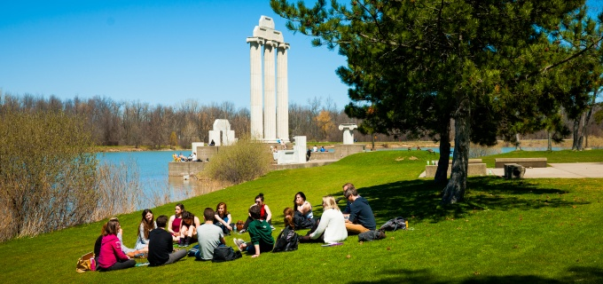 Students sitting in a circle near Baird Point.