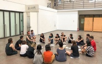 Students participate in a movement and performance workshop.