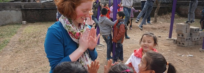 Woman interacting with children in china.