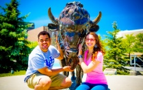 Two students with the Buffalo statue