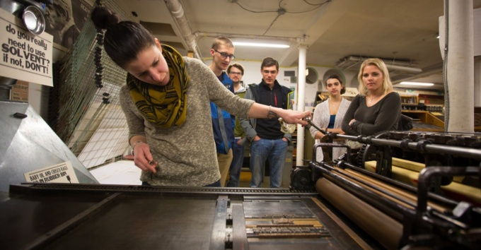 Students observing a letterpress workshop.