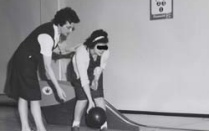 two students from the 1960s bowling.