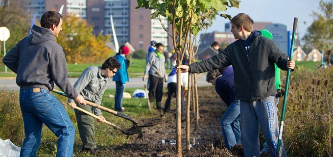 Students planting trees along on North Campus.