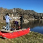 The researchers built a simple pontoon. They rode the boat into the middle of isolated lakes to collect samples of lake-bottom mud, which holds clues about the history of precipitation in a region in Greenland