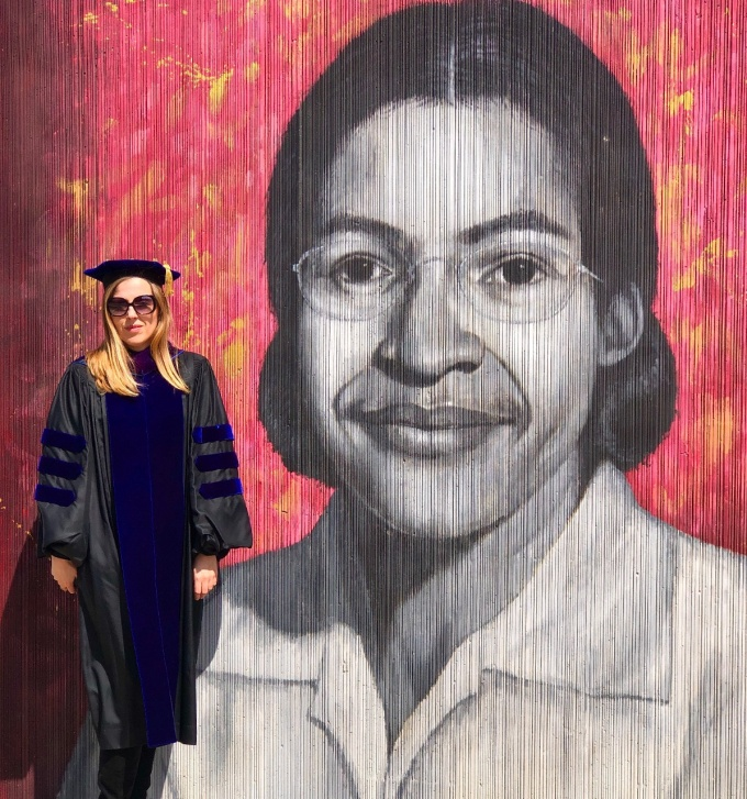 Karolina Kulicka, recent grad, in front of Rosa Park's mural on the Buffalo Freedom Wall.