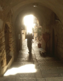 A man and child walk through old Jerusalem.