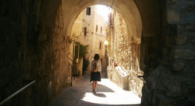 A student walking in the Old City in Jerusalem.