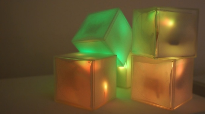 Lighted cubes stacked.