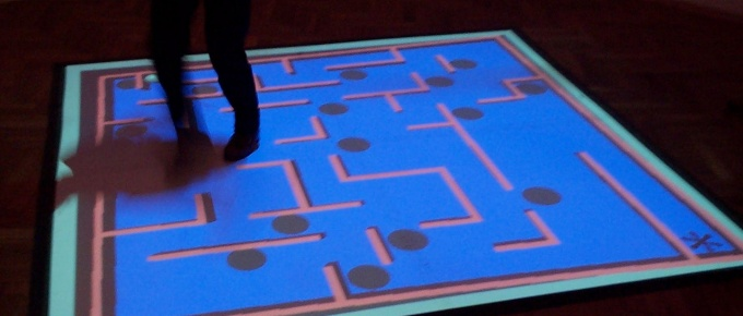 Interactive game projected on the floor.