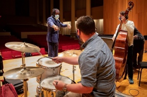 Michael Mwenso points to a student drummer during a class. Photo: Meredith Forrest Kulwicki.