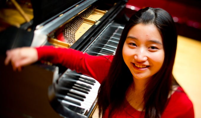 Music Student Tingfei Li in Slee Hall on North Campus.