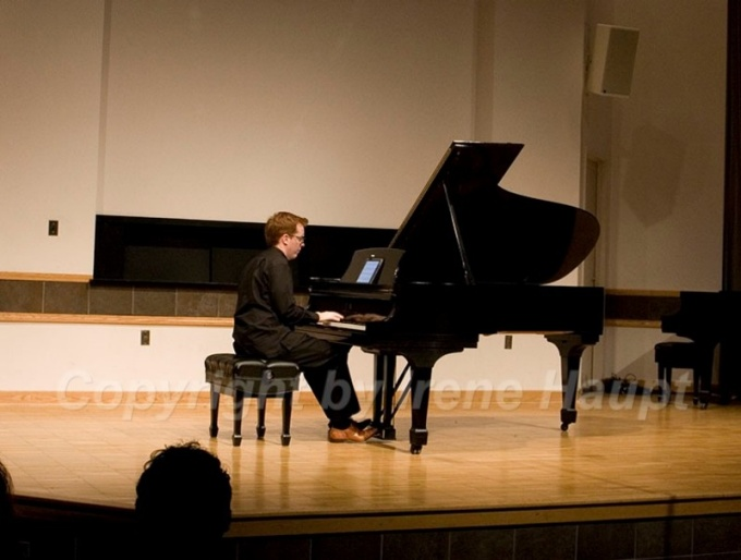 A Performance Institute member playing the piano.