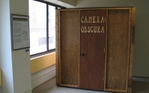 The camera obscura consists of a well sealed box with a pinhole on the front wall.