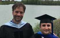 Prof. Jacob Kathman with student Muhammed Erenler at graduation
