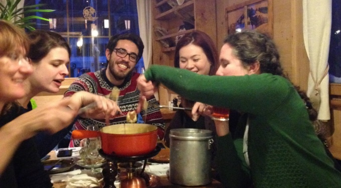 Students eating fondue in Lausanne, Switzerland.