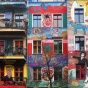 View of townhouses with colorful murals.