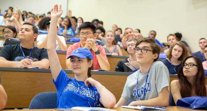 Students answer questions during freshman orientation.