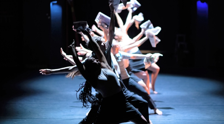 Dancers in green and white against a teal background.
