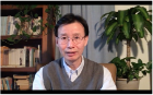 Professor Xuedong Hu addresses the department's graduates in a video message.