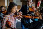 Graduate Music students teach violin to Buffalo immigrant and refugee students through Buffalo String Works (Photographer: Douglas Levere)