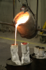 pouring bronze in the sculpture labs
