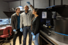 Assistant Professor Banerjee and his PhD students examines a microfluidic chip containing protein droplets. The group studies basic physical properties of intrinsically disordered proteins using optical tweezers, single-molecule fluorescence spectroscopy, and microfluidics.