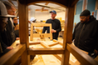 Jim Cordes, woodworking artist-in-residence at the Roycroft Campus in East Aurora, N.Y., gives a lesson to students in the spring term of the SACRA program in mid-May. Photo: Douglas Levere