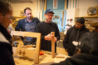 SACRA's lead instructor is Dennis Maher (center, left), a clinical assistant professor of architecture at the University at Buffalo. A rotating cast of craftspeople, including Jim Cordes (next to Maher), woodworking artist-in-residence at the Roycroft Campus in East Aurora, N.Y., offer demonstrations to the class. Photo: Douglas Levere