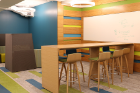 The space was designed with areas for students to gather. Conference rooms, casual seating nooks and kitchen spaces are tucked into various corners throughout the floor, along with plenty of dry-erase boards for mapping out new ideas on the fly.