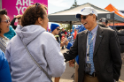 President Satish K. Tripathi greets fans at a tailgater before Saturday's game. Photo: Meredith Forrest Kulwicki