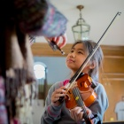 Student learning violin with Buffalo String Works