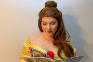 Jill Anderson dressed as Belle, reading book.