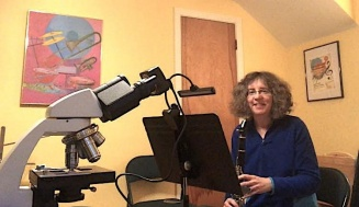 Professor Gail Seigel in her music room and home microscope lab.