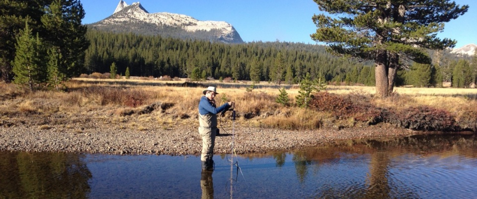 Chris Lowry conducting research in a river.
