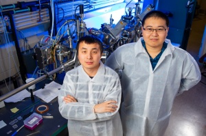 Researchers Xiucheng Wei and Haolei Hu standing in a laboratory.
