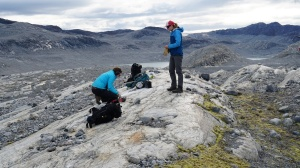 Scientists Jessica Badgeley and Alia Lesnek collecting rock samples in Greenland.