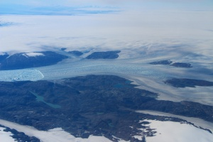 A large river of ice — Helheim Glacier — viewed from above.
