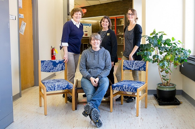 A group of lab tech in biology worked together to gather and repurpose surpluss funiture to create more stident-friendly study space in Hochstetter Hall. Back row, left to right: Barbara McCabe, Catherine Pollina and Kristie Reilly. In front, Shanna Snider. .