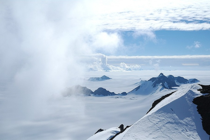 Summer clouds swirl in around the Staccato Peaks of Alexander Island, Antarctic Peninsula.