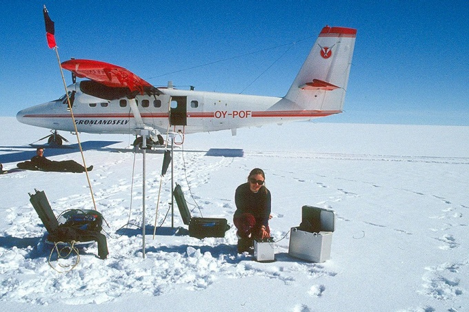 Beata Csatho, chair of the University at Buffalo Department of Geology, makes gravity measurements on the Greenland Ice Sheet. A renowned climate scientist, she will attend the September launch of NASA's new ice-monitoring satellite, ICESat-2.