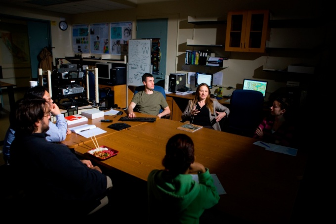 Beata Csatho and her research group sit around a conference table at a meeting.