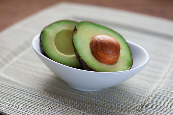 Bowl with a cut avocado.