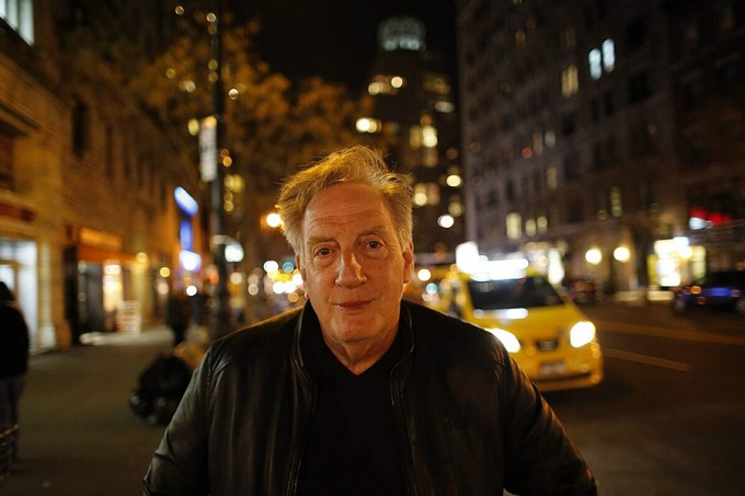 Alan Zweibel pictured in an urban evening setting.
