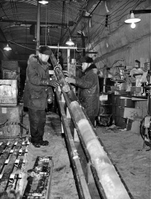 Engineers with the Cold Regions Research and Engineering Laboratory capture part of an ice core at Camp Century, Greenland, circa 1966.
